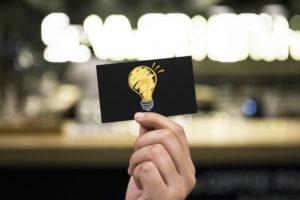 Light bulb drawn on paper
